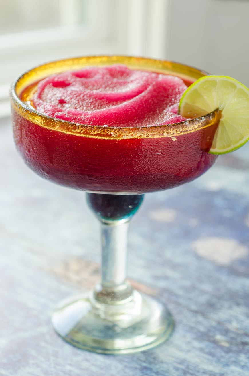 Frozen prickly pear margarita in large margarita glass