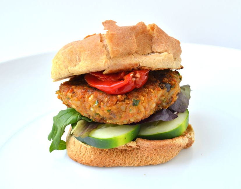 This spiced sweet potato black bean burger, is packed full of veggies and protein. Garam-masala and serrano pepper give it an extra kick