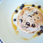 These vegan whole wheat blueberry pancakes are a great way to use blueberries this summer. They're sweet, fluffy, and delicious.