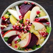 This vegan recipe for Noche Buena salad or Mexican Christmas Eve salad has crisp lettuce, apples, oranges, jicama, beets, and pomegranates.