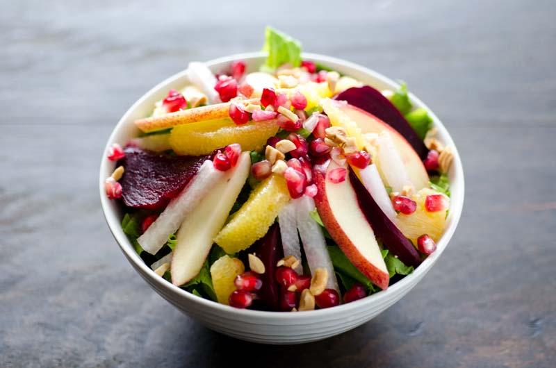 This vegan recipe for Noche Buena salad or Mexican Christmas Eve salad has crisp lettuce, apples, oranges, jicama, beets, and pomegranates.