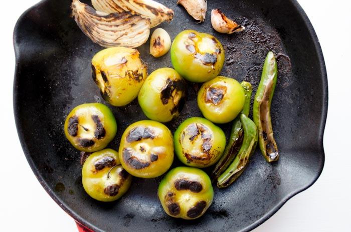Tomatillos roasting for salsa.