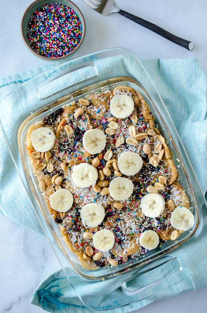 This recipe for vegan capirotada is toasted bread soaked in a piloncillo-cinnamon syrup layered with bananas, peanuts, raisins and coconut.