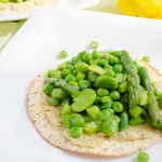 spring vegetable and hummus tostadas