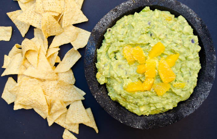 Roasted garlic and orange guacamole, sweet orange contrasts with the creamy avocado, the smoky roasted garlic and chiles permeate throughout