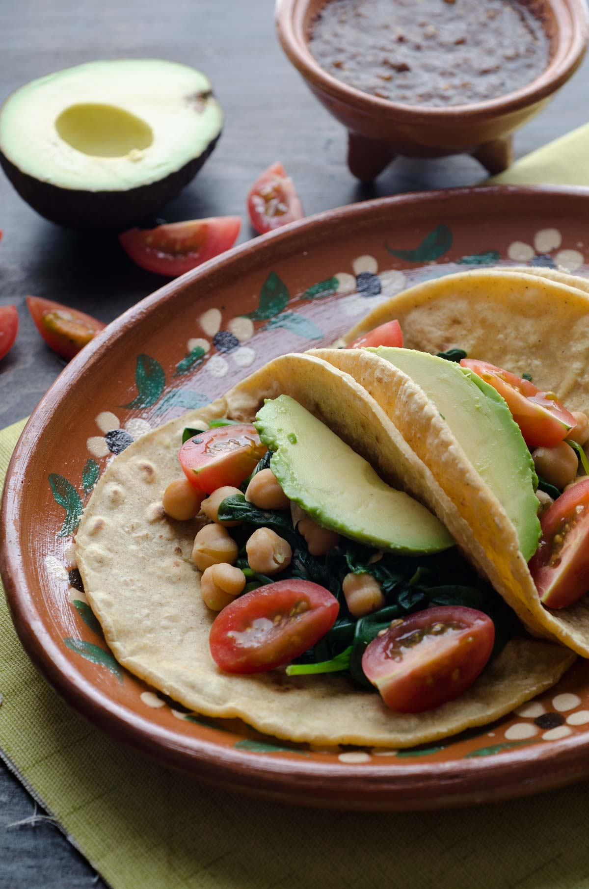 This recipe for chickpea and spinach tacos is my go-to easy lunch. Serve on warm corn tortillas, topped with cherry tomatoes, avocado, salsa, and pepitas.