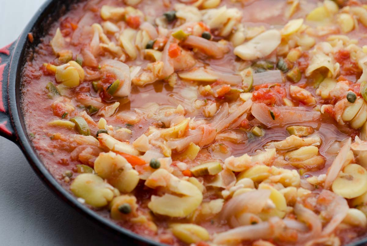 Veracruz-style fava bean stew, fava beans braised in onion, garlic, tomato, olives, capers, and pickled jalapeños. It is spicy and comforting