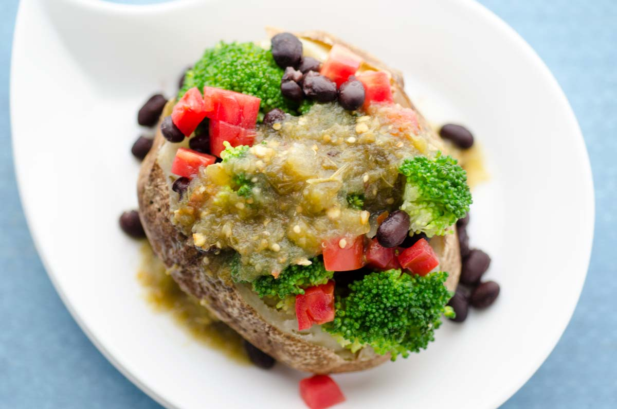 This Mexican stuffed baked potato is my go-to lunch. I just stuff a baked potato with broccoli, black beans, chopped tomato, and salsa verde.