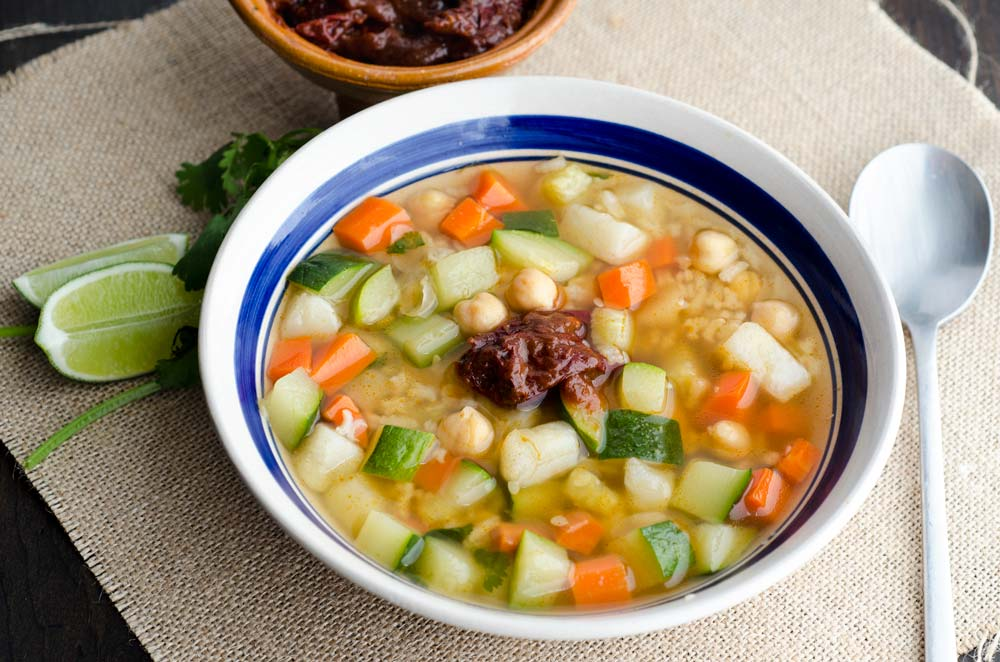 This vegan caldo tlalpeño recipe will keep you coming back for more. Zucchini, potatoes carrots and rice simmer in a chipotle vegetable broth