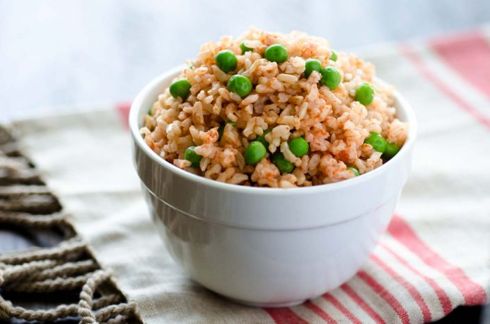 The perfect vegan Mexican brown rice, made with a very traditional recipe. It has just the right texture and balance of tomato-garlic flavor.