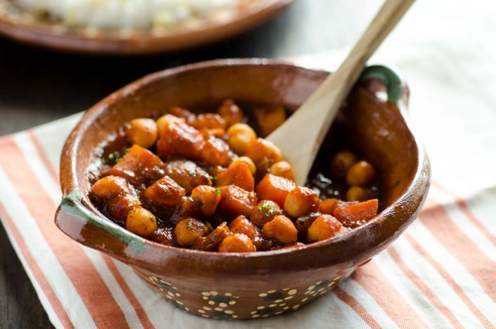 This sweet potato and chickpea stew combines sweet potatoes, yukon gold potatoes and chickpeas in a classic chile colorado sauce.
