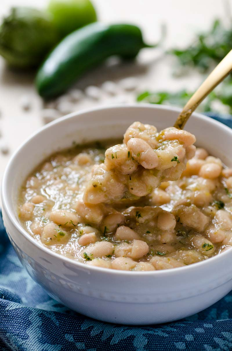 These tomatillo poblano white beans are a warm stew of perfectly creamy beans, tomatillos, spicy poblano pepper, onion, cumin, and oregano.