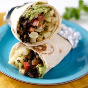 This vegan California burrito is stuffed with baked french fries, pico de gallo, portobello asada, spicy salsa, vegan cheese, and guacamole.