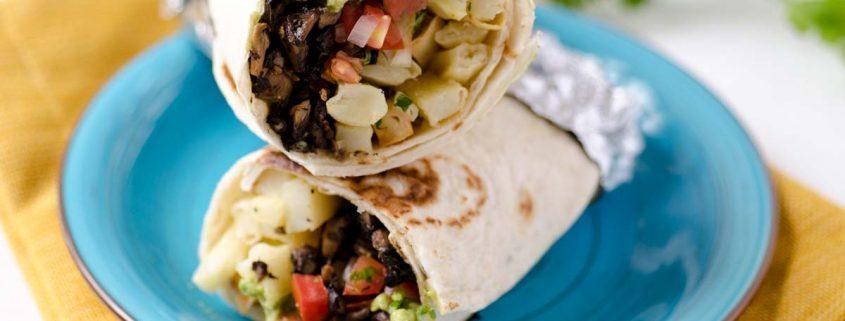 This vegan California burrito is stuffed with baked french fries, pico de gallo, portobello asada, spicy salsa, vegan cheese, and guacamole.