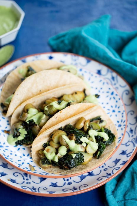 These kale potato tacos topped with cilantro cream sauce are the easiest thing in the world to make, they are also delicious and nutritious.
