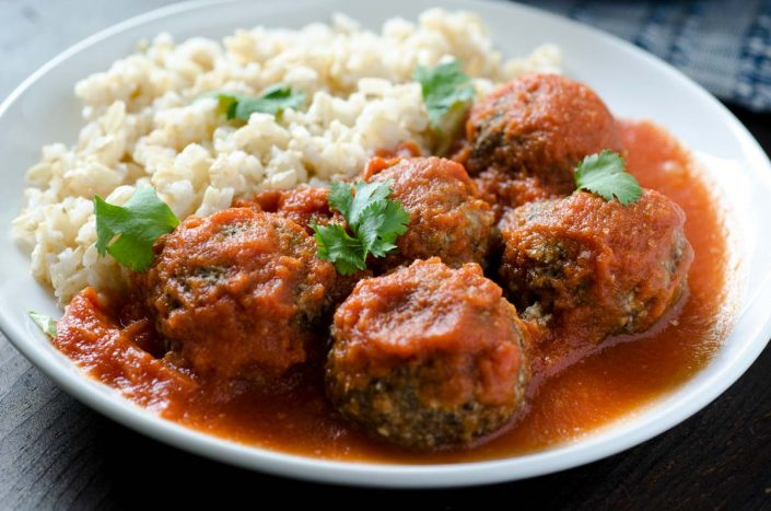 Tofu meatballs made with a mix of tofu, mushrooms, onion, garlic and seasonings, and bathed in a spicy chipotle tomato sauce. #veganmexicanrecipes