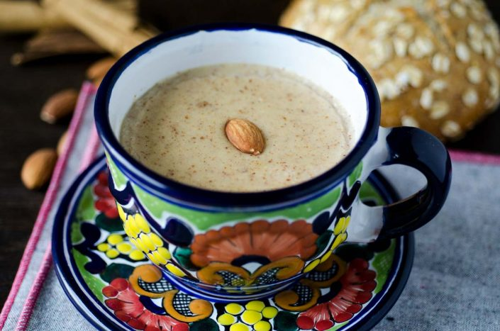This almond atole combines almond milk, ground almonds, cinnamon. piloncillo, and masa harina to make a warm, comforting, and sweet beverage.