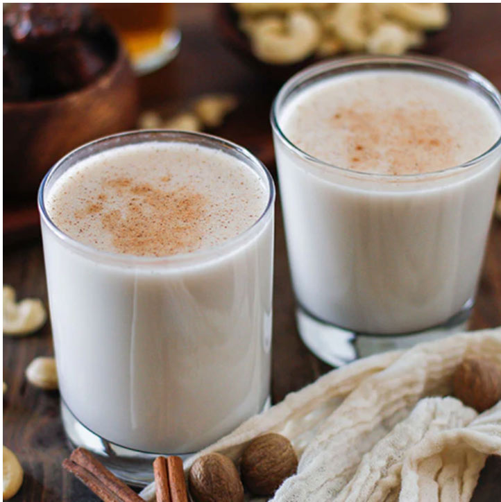 two glasses of rompope sprinkled with cinnamon