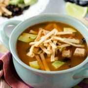 This spicy vegan tortilla soup, is not your typical tex-mex, cumin and chili powder seasoned soup. The broth for this soup is simmered with epazote, chile morita, tomato, onion, garlic, and chipotle, then garnished with fried or baked tortilla strips, baked tofu, crispy chile ancho, and avocado.