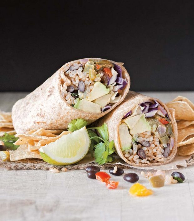 This chipotle and lime burrito is stuffed with a mixture cilantro-lime rice and beans, sautéed spicy peppers, and a smoky chipotle cream sauce. From the book Vegan Burgers and Burritos by Sophia De Santis.