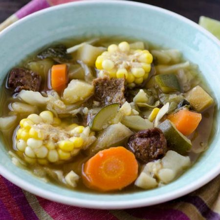 Caldo de res or vegan Mexican beef soup is a warm comforting soup of stewed beef, carrots, potatoes, corn, chayote, potatoes, mint, and cilantro. It is served all year, but is especially good in the winter months.