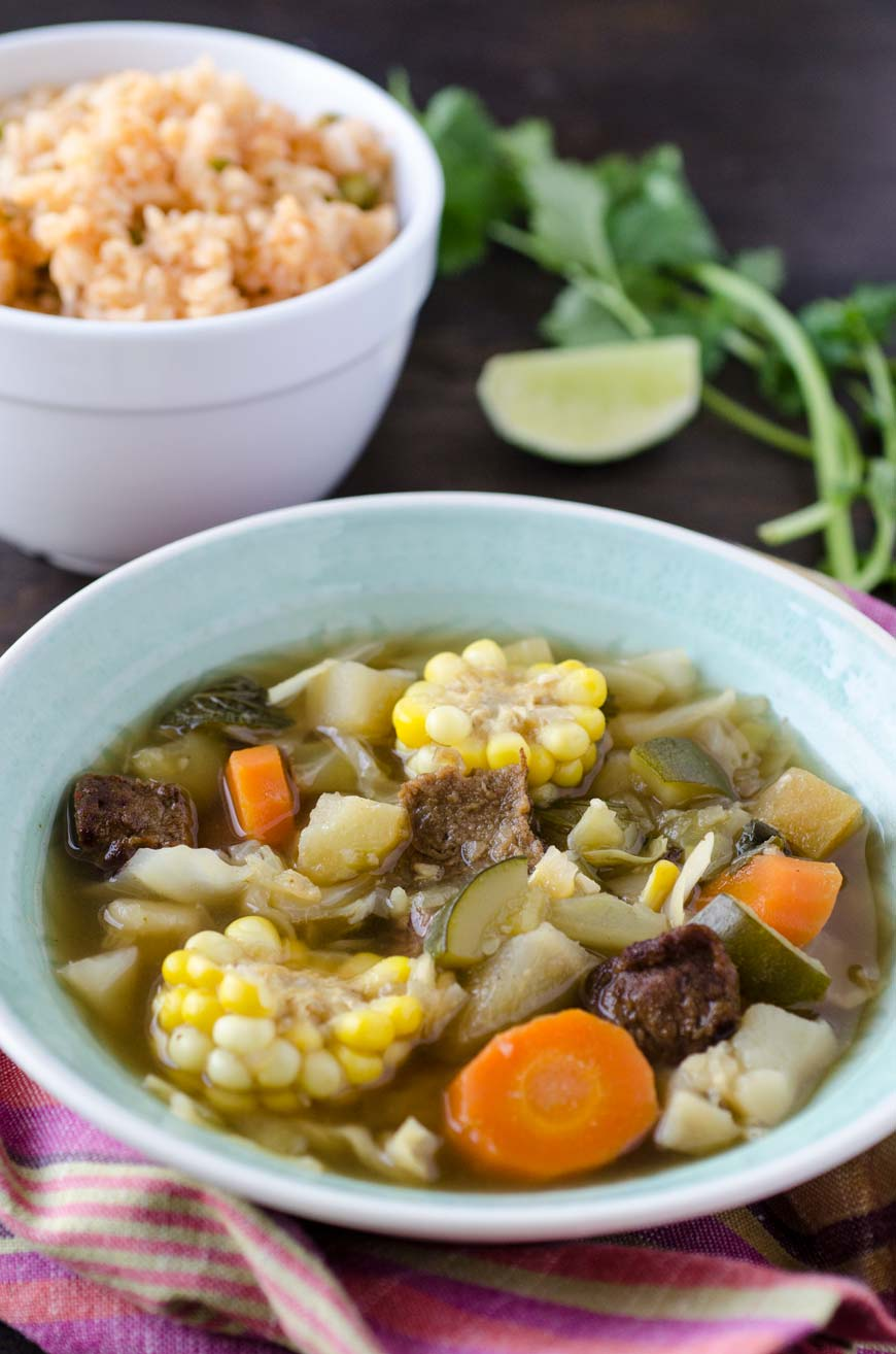 vegan Caldo de res or vegan Mexican beef soup is a warm comforting soup of stewed beef, carrots, potatoes, corn, chayote, potatoes, mint, and cilantro. It is served all year, but is especially good in the winter months.