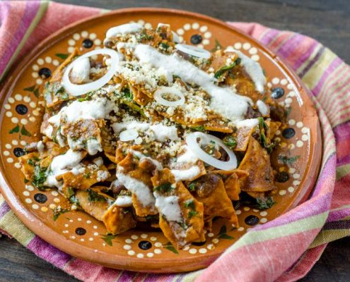 Home doras table vegan mexican recipes vegan mole chilaquiles are tortilla chips covered in mole sauce and mixed with sauted greens and forumfinder Choice Image