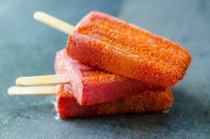 This watermelon paleta shot is a combination of sweet watermelon, lime juice, tequila, and chile powder. So good it makes my mouth water!