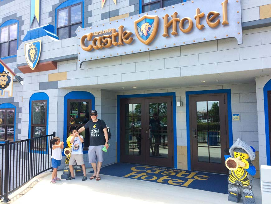 Family in front of legoland califonia castle hotel