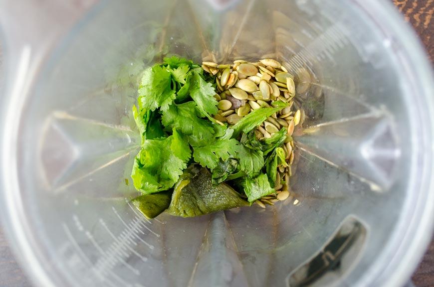 pumpkin seeds, tomatillos, cilantro and poblano in blender for vegan pozole verde