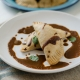vegan empanadas on a white plate with mole sauce