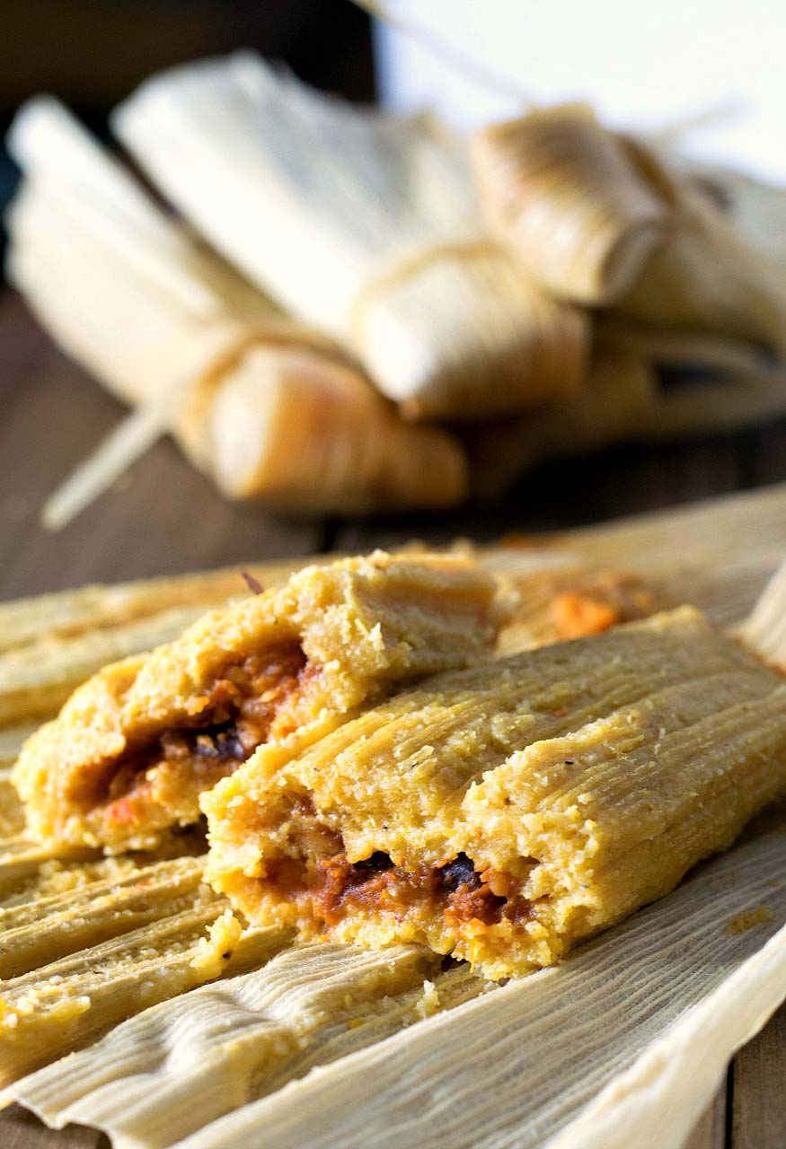 Oil-Free Tamales filled with black beans, sweet potatoes, and green chiles cut in half.