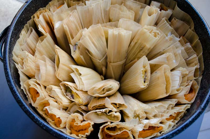 Tamales arranged in a steamer pot