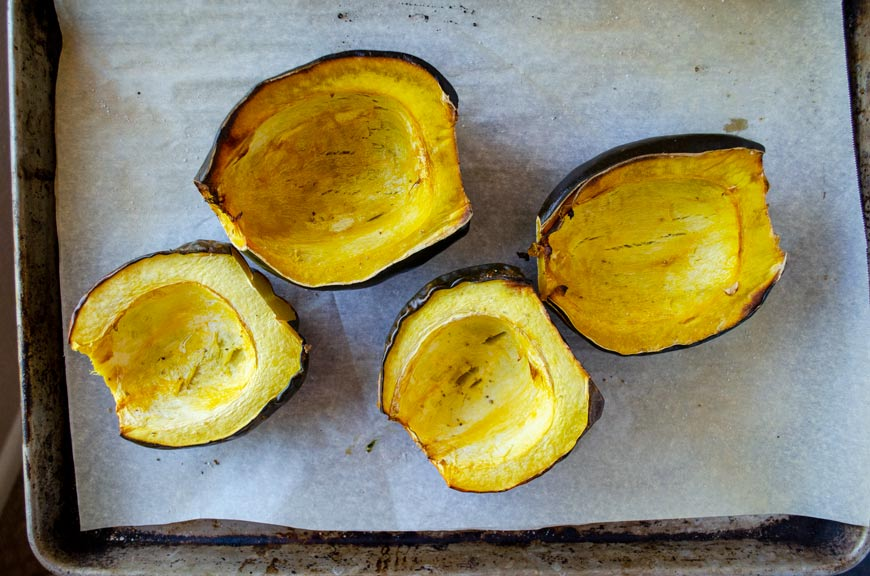acorn squash on a sheet tray after being roasted