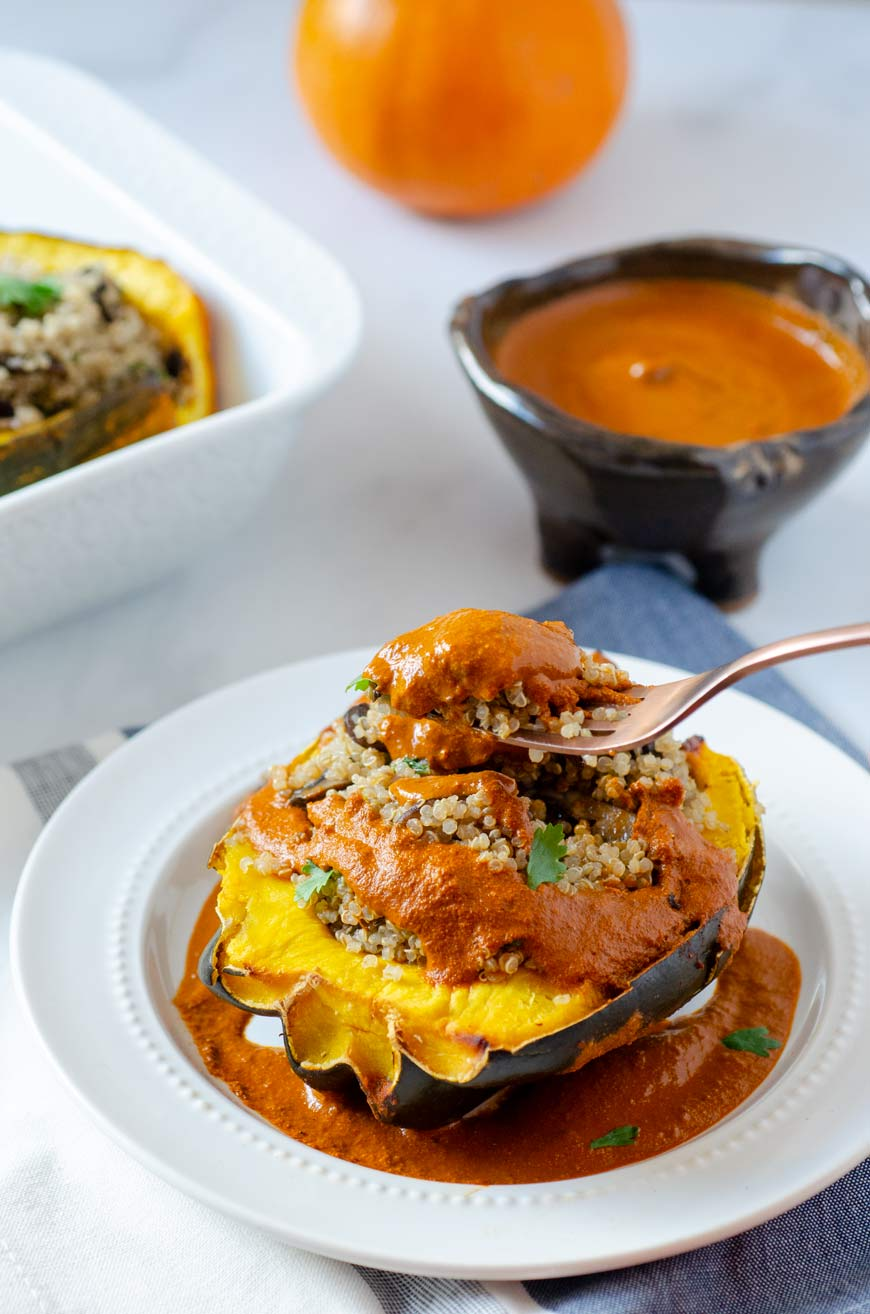 a fork in the quinoa stuffed acorn squash