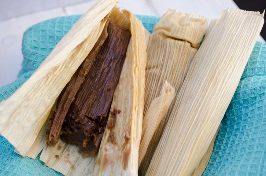 chocolate tamales on a blue kitchen towel
