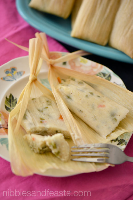 Jalapeño and cactus tamales on a white plate