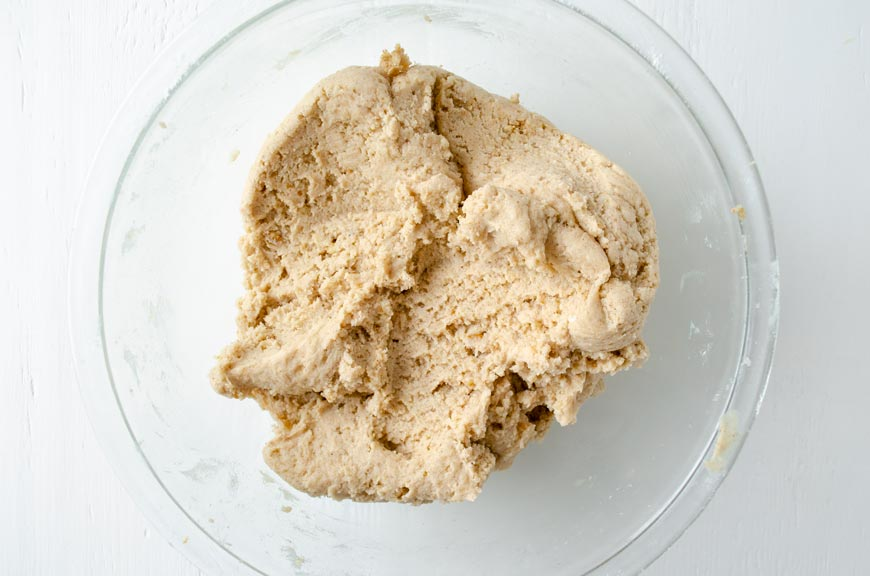 dough for vegan mexican wedding cookies in a large glass bowl