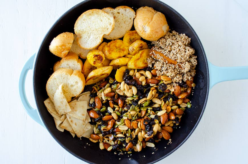nuts, bread, tortillas, sesame seed and spices in a cast iron pan