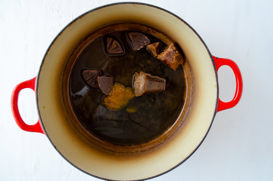 Piloncillo, chocolate, and bouillon cubes in a large pot