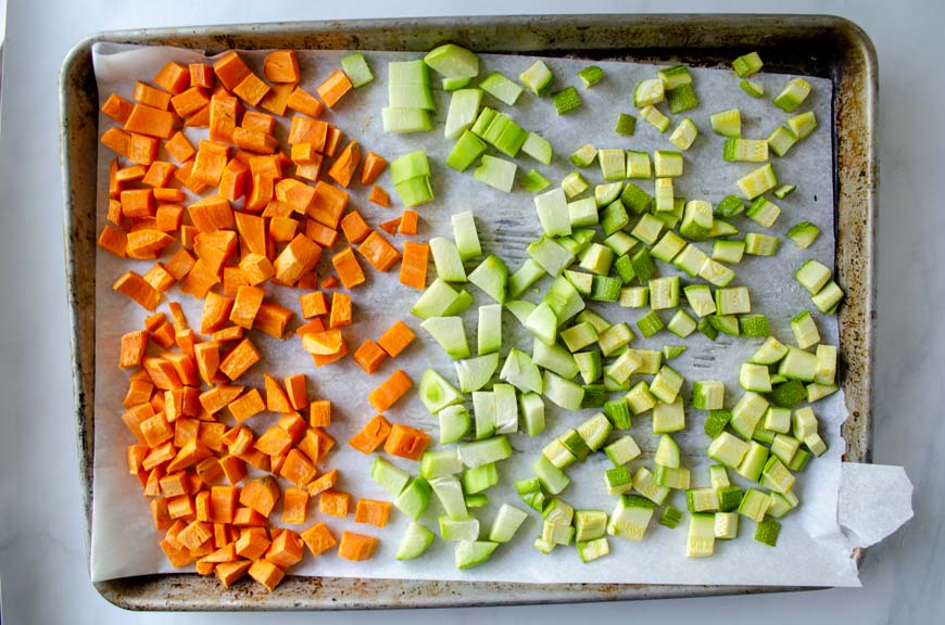 diced sweet potato, chayote, and zucchini on a sheet tray for atapakua