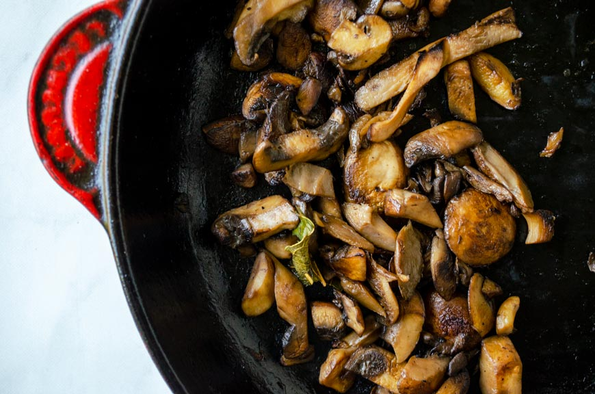 sauteed mushrooms in a cast iron pan