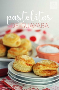 a large plate filled with guava pastelitos and a smaller plate with two pastelitos in focus