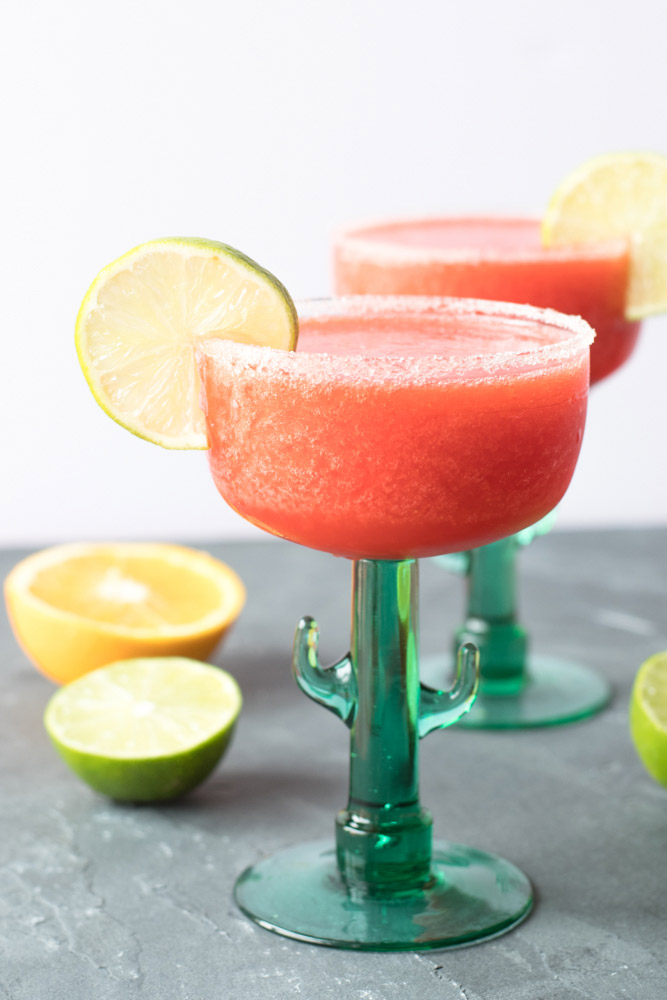 strawberry frozen margarita in a cactus margarita glass for cinco de mayo party food ideas