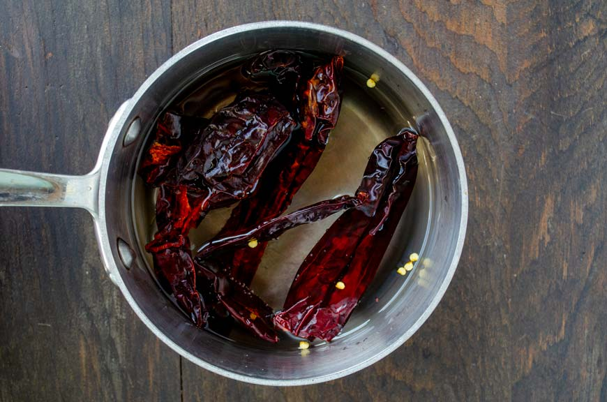 Stainless steel pot filled with dried chiles and water