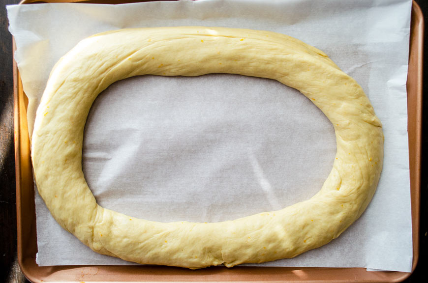 Dough rolled out and formed into an oval shape, place on a sheet tray.