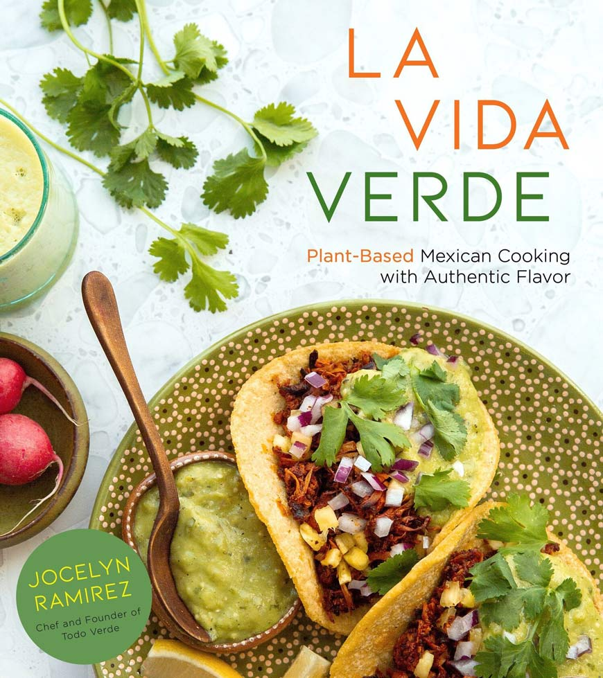 vida verde cookbook cover two jackfruit tacos with cilantro and red onion on a a green clay plate with flowers