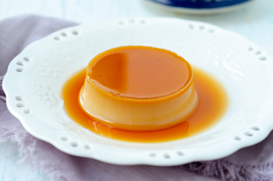 a close up of the vegan flan covered in caramel