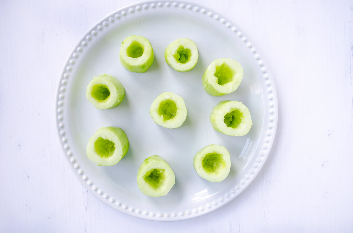 cucumber cups on a white plate with a dotted rim