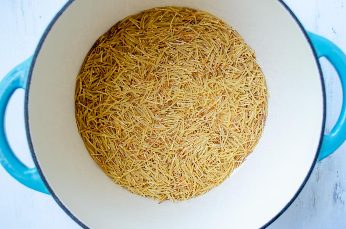fideos toasting in a pot